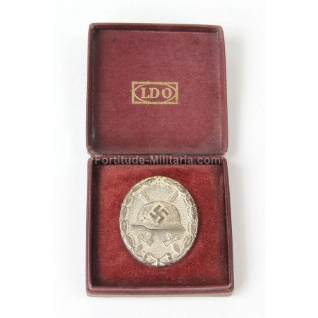 Silver wound badge in box